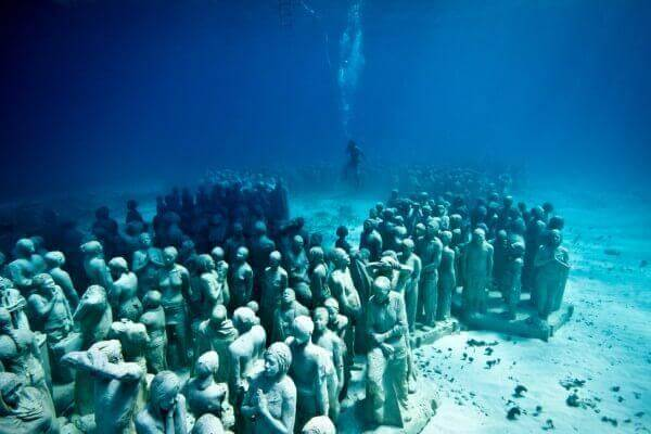 Silent evolution underwater sculpture - Cancun Mexico