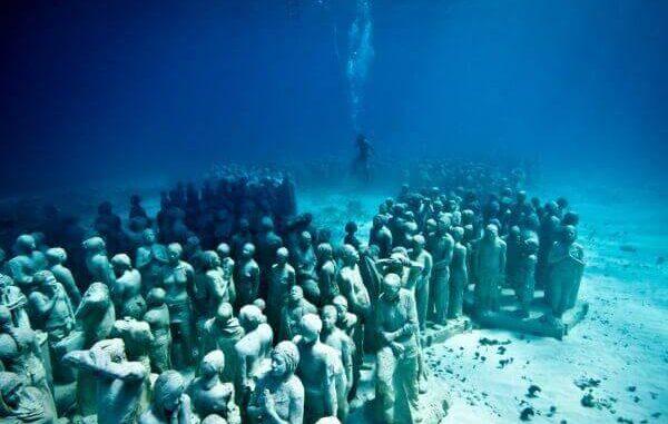 Silent evolution underwater sculpture - Cancun Mexico